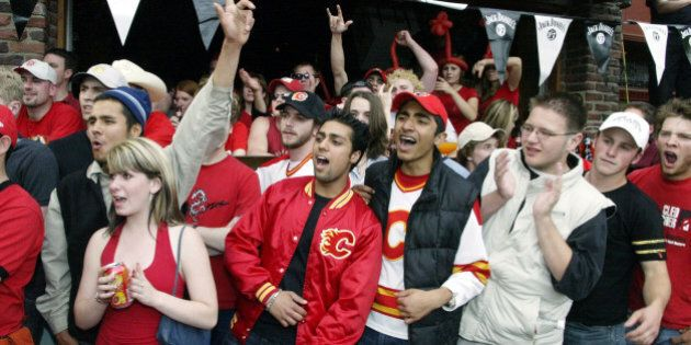 CALGARY, CANADA - JUNE 5: Calgary Flames fans watching the game outside Melrose restuarant on 17th Avenue,...