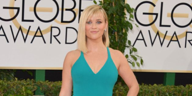 Reese Witherspoon arrives at the 71st annual Golden Globe Awards at the Beverly Hilton Hotel on Sunday,...