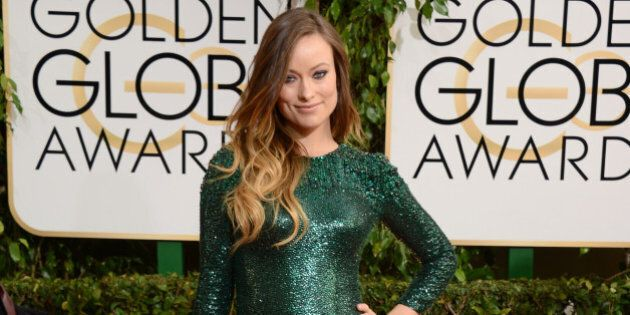 Olivia Wilde arrives at the 71st annual Golden Globe Awards at the Beverly Hilton Hotel on Sunday, Jan....