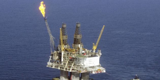 IN FLIGHT - APRIL 21: A flame burns off excess gas fumes on the top of the five-billion dollar drilling...