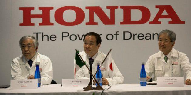 Tetsuo Iwamura, executive vice president of Honda Motor Co., from left, Takanobu Ito, chief executive...