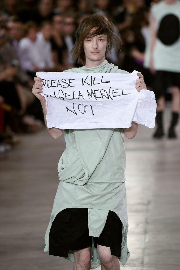 Model Holds 'Please Kill Angela Merkel' Sign During Rick Owens Spring/Summer 2016