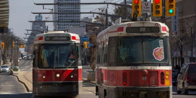 TORONTO, ON - APRIL 2: Lansdowne 512 streetcars pass each other at Wychwood Ave and St. Clair Avenue....
