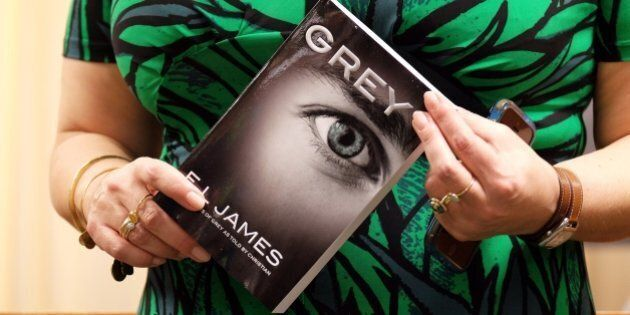 British author E.L. James poses with a copy of her new book 'Grey: Fifty Shades of Grey as Told by Christian' at the Barnes and Noble store on Fifth Avenue in New York on June 18, 2015. The 'Fifty Shades' trilogy is a record-breaking contemporary publishing phenomenon, selling more than 125 million copies worldwide and translated into more than 50 languages. AFP PHOTO/JEWEL SAMAD        (Photo credit should read JEWEL SAMAD/AFP/Getty Images)