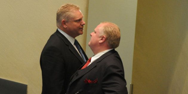 MAY 17th .2011.pics of. mayor rob ford speaks to his brother Doug Ford after speaking. contractinng out...
