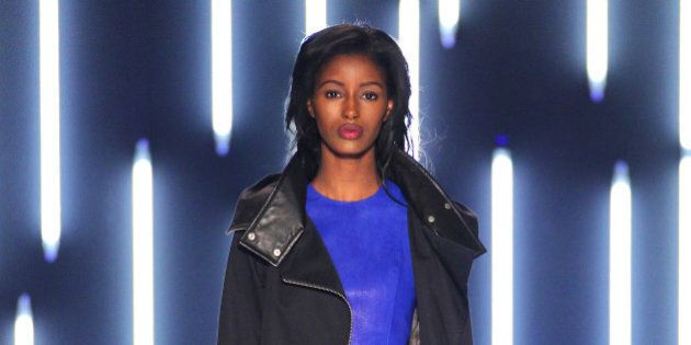 TORONTO, ON - OCTOBER 22: A model walks the runway at the Mackage Spring/Summer 2015 fashion show during...