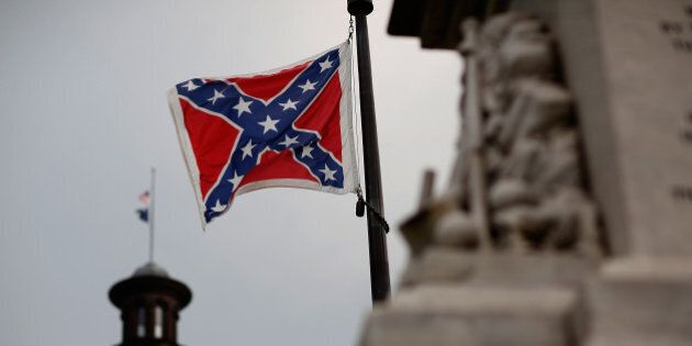 COLUMBIA, SC - JUNE 23: The Confederate flag flies on the Capitol grounds one day after South Carolina...