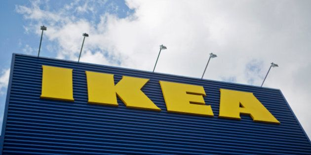 The Ikea AB logo sits on a store in Stockholm, Sweden, on Wednesday, June 13, 2012. IKEA, the retailer...
