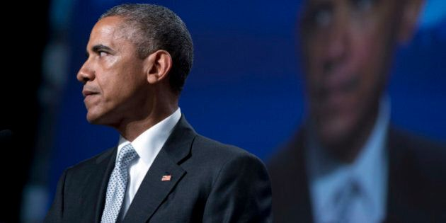 President Barack Obama pauses as he speaks about gun violence at the Annual Meeting of the U.S. Conference...