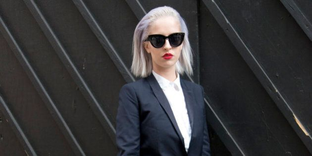 LONDON, ENGLAND - JUNE 15: Fashion blogger Lucy Anderson wears Kooples suit, Topshop sunglasses, H and M shoes, Zara shirt and Louis Vuitton bag on day 4 of London Collections: Men on June 15, 2015 in London, England.  (Photo by Kirstin Sinclair/Getty Images)