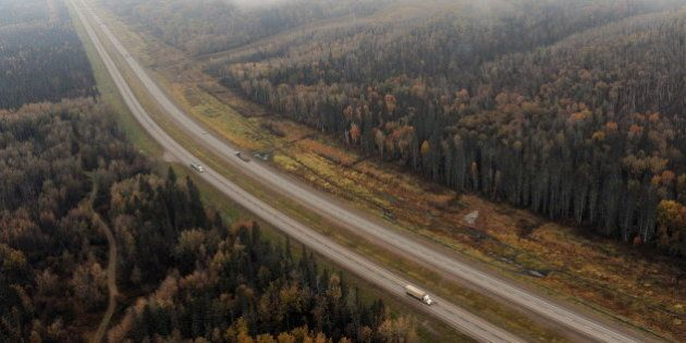Aerial view of Alberta Highway 63 which runs through the oil sands town of Fort McMurray on October 23,...
