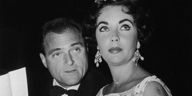 British-born actor Elizabeth Taylor sits with her third husband, American film producer Mike Todd (1909...