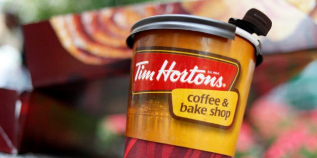 A Tim Hortons' coffee cup is seen in New York, Wednesday, July 22, 2009. The Canadian doughnut chain...