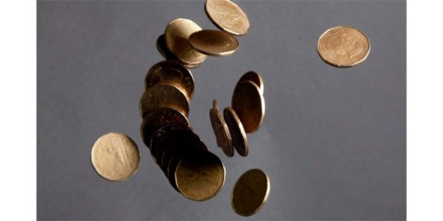 Loonie Hits 4-Year Low After Bad Economic