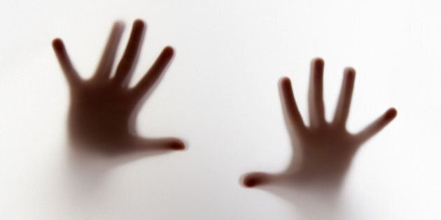 hands silhouette behind a