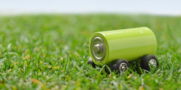 Green battery car on the lawn