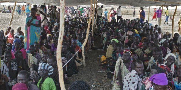 IDP's (Internally displaced persons) wait to receive food rations at the UNMISS Protection of Civilian...