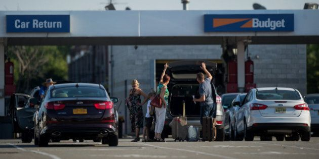Customers return a rental car to the Avis Budget Group Inc. location for LaGuardia Airport (LGA) in the...