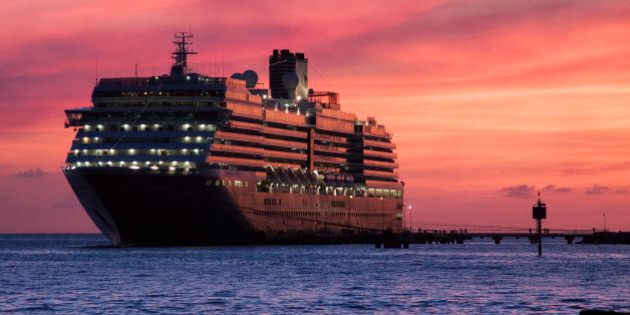 [UNVERIFIED CONTENT] Sunset with view of the Holland America Line cruise liner MS Zuiderdam anchored...