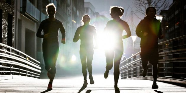 small group of runners in urban invironment, evening