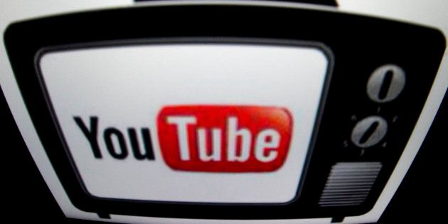 The 'YouTube' logo is seen on a tablet screen on December 4, 2012 in Paris. AFP PHOTO / LIONEL BONAVENTURE...