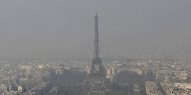 FILE - In this March 14, 2014 file photo, the Eiffel Tower, is photographed through the smog in Paris....