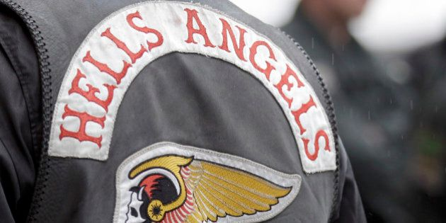 Police officers guard members of the rocker gang Hells Angels at the entrance of the district court in...