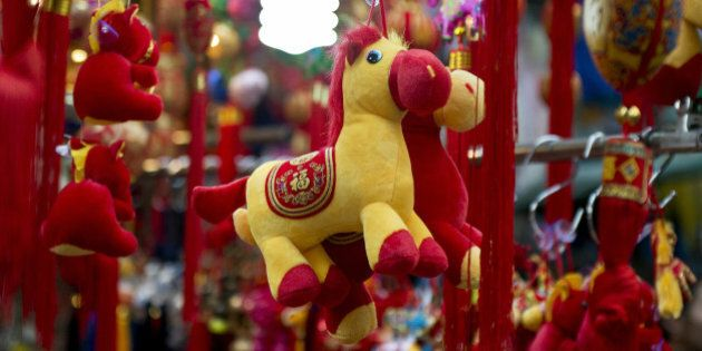 Horse figures are put on display at a street market stall selling Chinese New Year items in Hong Kong on January 3, 2014. The Chinese New Year of the horse falls on January 31. AFP PHOTO / ALEX OGLE (Photo credit should read Alex Ogle/AFP/Getty Images)