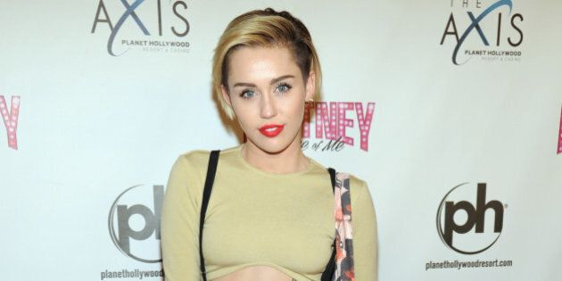 LAS VEGAS, NV - DECEMBER 27: Singer Miley Cyrus attends the opening of 'Britney: Piece of Me' at Planet...