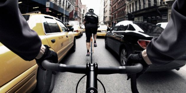 The handlebar view of a bike courier in New York City.