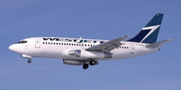 Description A Boeing 737-200Adv (C-GXWJ) of WestJet on approach to Ottawa Airport | Source http://www. airliners. net/photo/WestJet/Boeing- ...