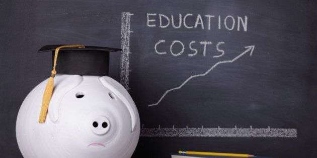 Big piggybank with a graduation cap is standing next to an education chart showing a rising trend in...