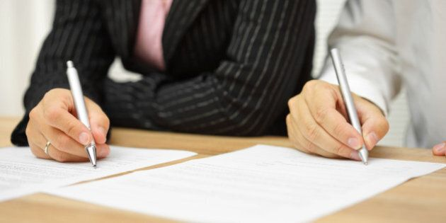 businesswoman and businessman signing contract in the