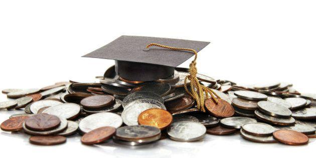 graduation cap on a pile of money ( student debt