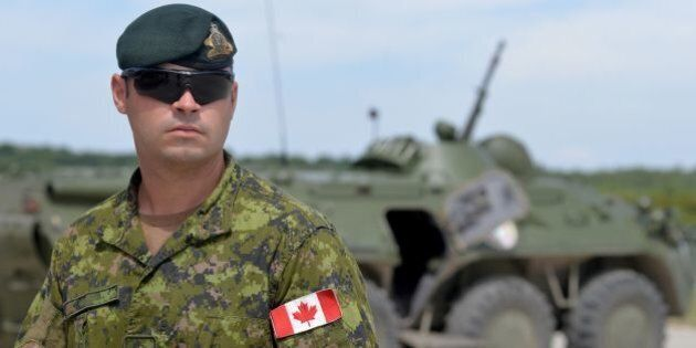 A Canadian military instructor looks on during Ukrainian military exercises at the International Peacekeeping...