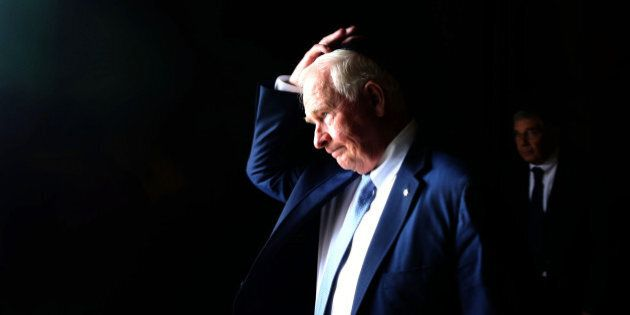 Canadian Governor General of Canada David Johnston adjusts his kippa on November 2, 2016 during a visit...