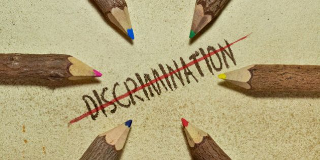 Conceptual image with pencils on vintage background to stop discrimination. Six handcrafted wooden pencils...
