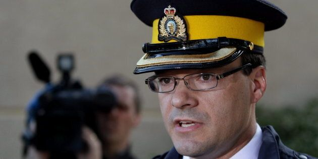 RCMP Insp. Tim Shields speaks to reporters on April 9,