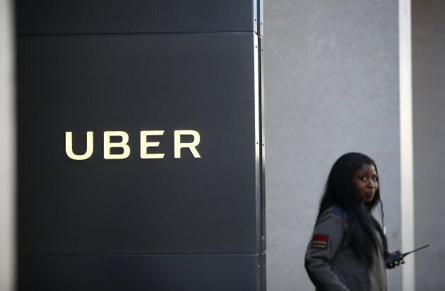 A private security guard stands in front of Uber headquarters on June 13, 2017 in San Francisco,