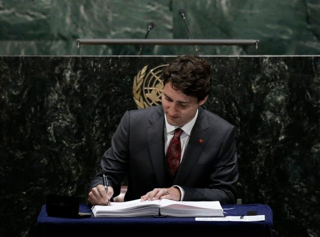 Prime Minister Justin Trudeau signs the Paris Agreement on climate change at UN headquarters in New York...