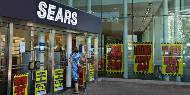A customer enters a shuttering Sears store in downtown Vancouver, B.C., Sept. 13,