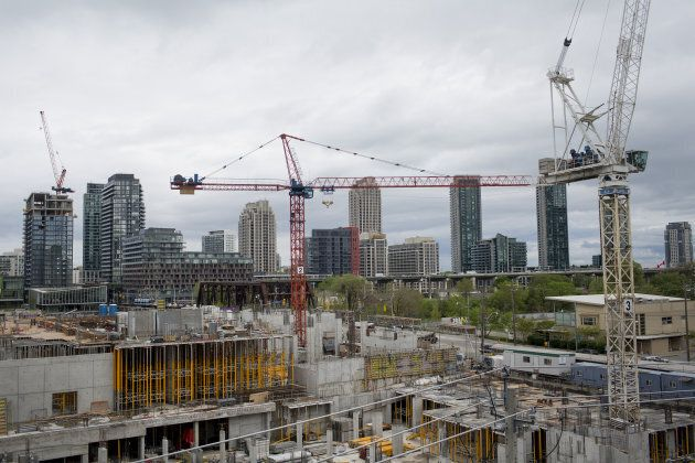 A crane operates at the Minto Westside condominium under construction in Toronto on May 26, 2017.