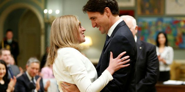 Prime Minister Justin Trudeau congratulates Karina Gould after she was sworn-in as Minister of Democratic Institutions during a cabinet shuffle at Rideau Hall in Ottawa on Jan. 10, 2017.