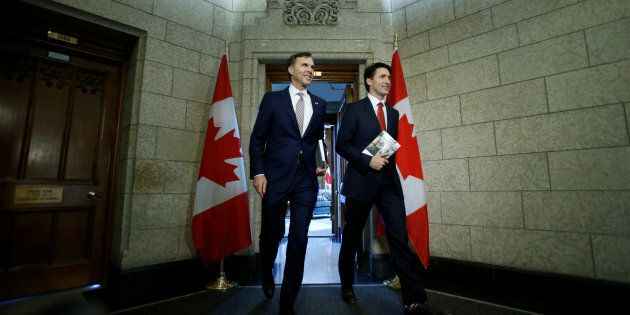 Prime Minister Justin Trudeau and Finance Minister Bill Morneau walk from Trudeau's office to deliver...