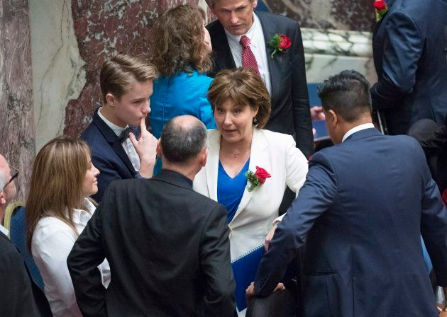 Premier Christy Clark speaks with colleagues prior to the Speech from