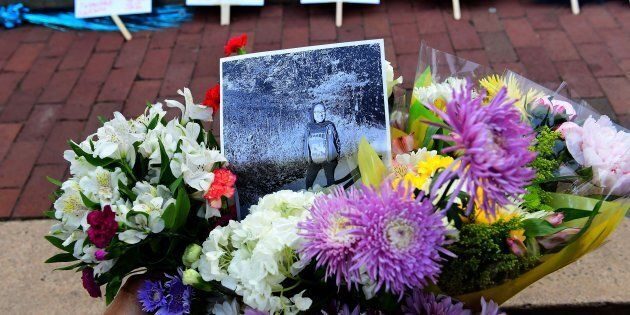 Friends, family, neighbors and strangers bring flowers  to a vigil  for Nabra Hassanen at Lake Anne Plaza  June 21, 2017 near Reston, VA.   Hassanen was killed by a 22-year-old while walking near her mosque.(Photo by Katherine Frey/The Washington Post via Getty Images)