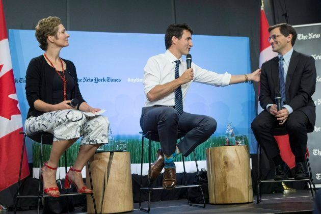 Prime Minister Justin Trudeau, centre, sits alongside Peter Baker, chief White House correspondent of...