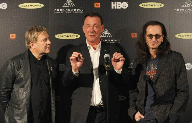 Alex Lifeson, Neil Peart and Geddy Lee of Rush at the 28th Annual Rock and Roll Hall of Fame Induction Ceremony April 18, 2013 in Los Angeles, California.  (Photo: Mark Sullivan/FilmMagic)