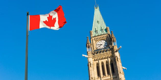 A Canadian flag is shown outside of Parliament in