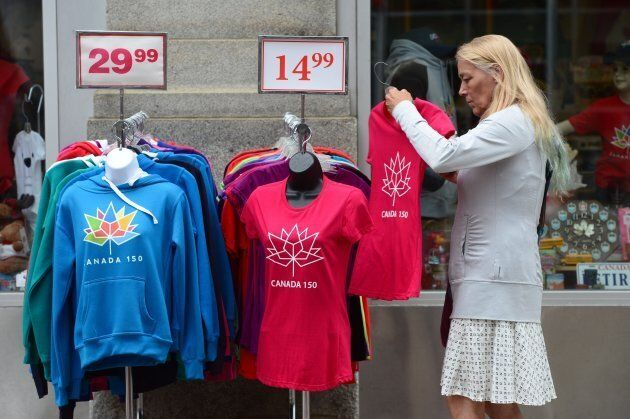 A woman looks at Canada 150 merchandise for sale in Ottawa on Thursday, June 22,